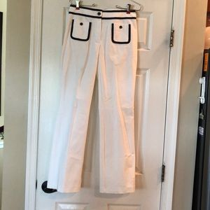 White pants with navy trim, front pockets